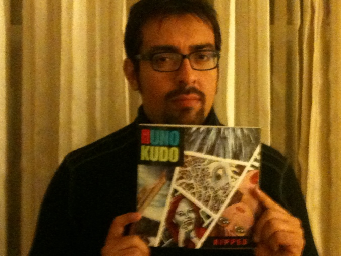 Here I am holding my copy of Uno Kudo, Vol. 1. It's a beauty.
